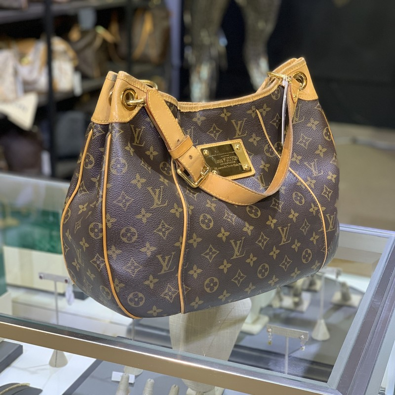 LV Galliera PM Mono, Size: MHH<br /> <br /> We guarantee this is an authentic LOUIS VUITTON Monogram Galliera PM or 100% of your money back. This stylish shoulder bag is finely crafted of classic Louis Vuitton monogram on toile canvas. The shoulder bag features an adjustable vachetta leather shoulder strap, vachetta leather piping and trim complete with polished brass hardware including a large engraved front plate. The top opens to a light beige microfiber interior with a flap pocket. Roomy enough to accommodate everyday essentials, this Louis Vuitton tote is ideal for everyday use!<br /> <br /> Original receipt included.<br /> <br /> Measurements<br /> Base Length: 15.25 in<br /> Height: 11 in<br /> Width: 4.75 in<br /> Drop: 7.5 in