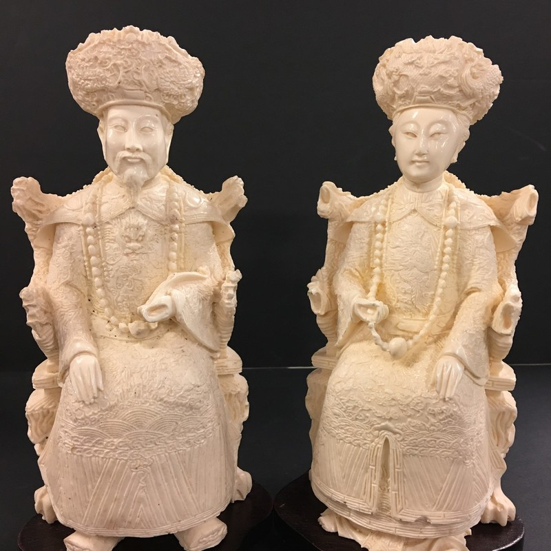 Hand carved royal figures. Emperor and Empress seated in their royal thrones. Decorative finials for head dress included under base of each figure. Resin. So much detail; beautiful condition!
