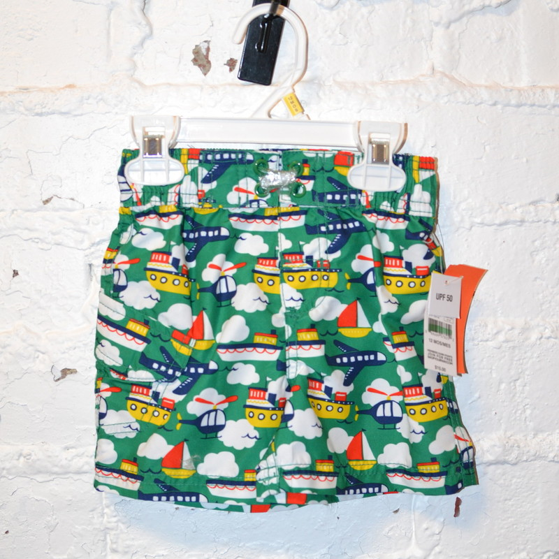 New with tags<br /> Original price $15<br /> Joe Boxer<br /> Green with boats, planes, and helicopters<br /> Tie wasteband<br /> 12 months