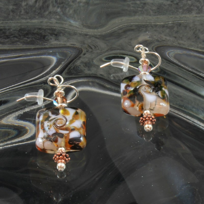From the Serengetti collection of Gladmist Glass Design. Hand torched glass beads with sterling silver, Swarovski crystals and copper accents.