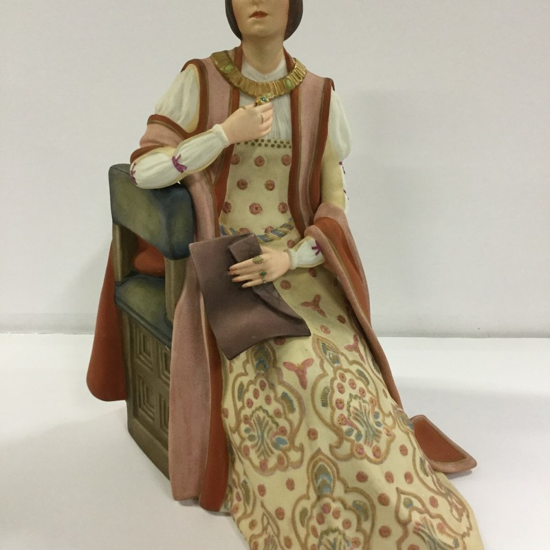 Beautiful Isabella seated; draped in jewels contemplating what might be written on the document she holds with her long; graceful fingers. Lovely floor length gown in shades of mauve; gold and blue.  Profiles in porcelain; Hutschenreuther made in Germany.  Signed by the artist.  Excellent condition!