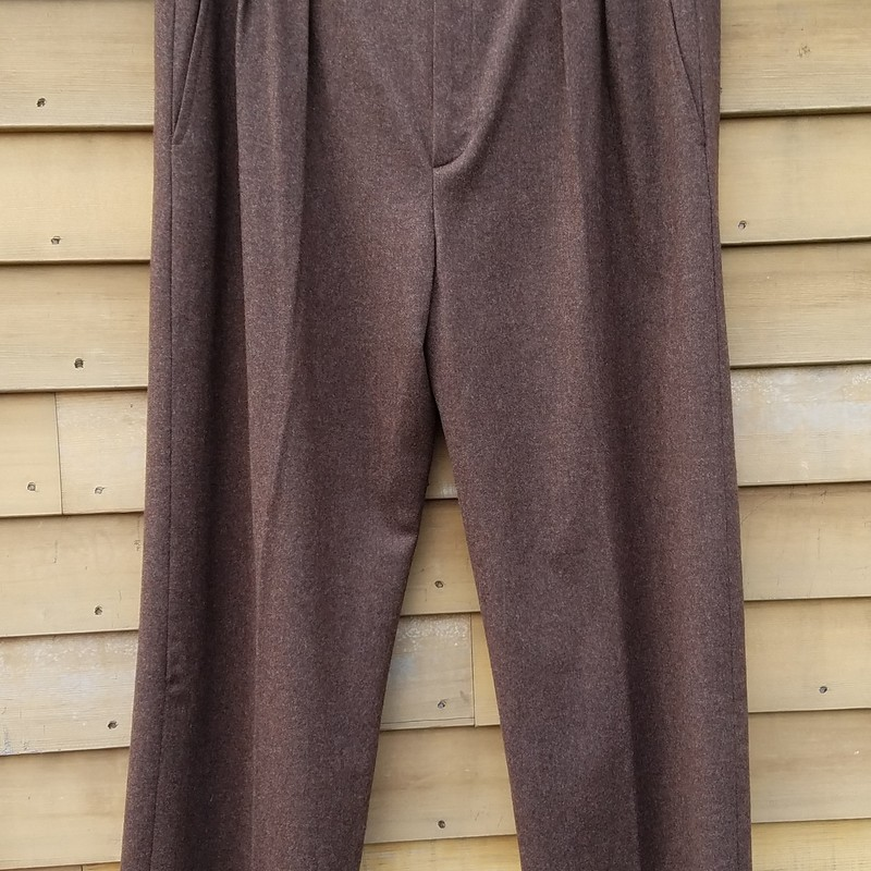 "VINTAGE Brown Wool Cashmere Blend trousers are designed to sit high on the waist for a flattering and feminine silhouette with Pleats. They benefit from button and zipper front fastening, and two side slit pockets.<br /> size 42      27.5"" inseam 35"" waist<br /> EUC<br /> RARE FIND<br /> <br /> Considered the pioneer of women's tailoring, French fashion designer Yves Saint Laurent founded his eponymous label in 1961. A master with cut and construction, his revolutionary pieces are still worn to this day."