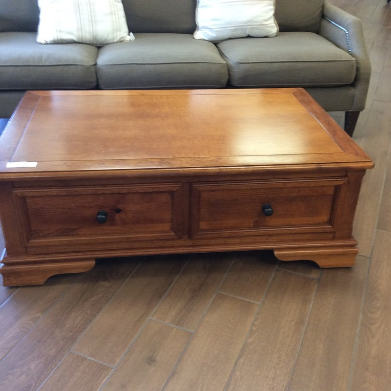This handsome coffee and end table set features solid wood construction (it looks like some pine, oak and maybe some walnut) and has a pretty maple finish. The coffee table has 2 roomy drawers, that are as deep as the table itself. There are also 2 faux drawers on the opposite side. The end table has 3 nice-sized drawers. The hardware on both pieces is a vintagy brushed bronze. Priced well!