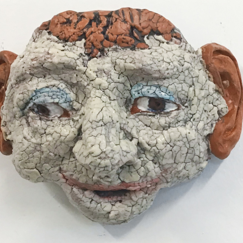 "Title: Crackled Mask With Big Ears, Artist: Fred Freeman, Medium: Clay, Size: 6""x4"""