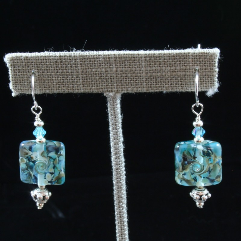 From the Seaside Cliffs collection of Gladmist Glass Design. Hand torched glass beads with sterling silver and Swarovski crystals.