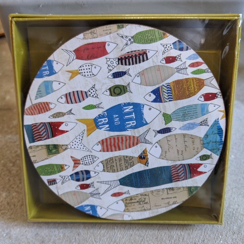 Our scratch resistant cork backed Fish Round Art Coasters features the ocean's most beloved creatures in an array of nautical colors. Set of four in a gift box, heat and moisture resistant, 4 inch diameter.<br /> Featured at Be Kind Creative