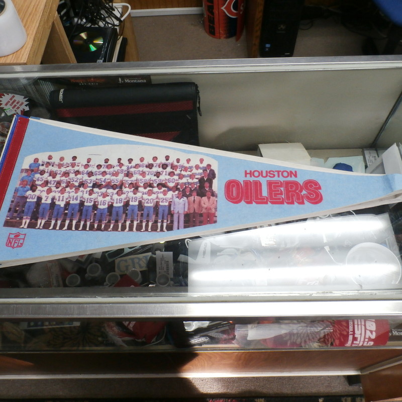 Houston Oilers NFL Pennant 30&quot; x 12&quot; Vintage Style Team Photo # 19012<br /> Rating: (see below)- 3 - Good Condition<br /> Team: Houston Oilers<br /> Player: Team Photo<br /> Brand: NFL<br /> Size: (Measured flat: Height: 12&quot;; length: 30&quot;)<br /> Color: Light Blue with Red accents<br /> Style: Pennant;<br /> Material: Unknown<br /> Condition: 3- Good Condition: wrinkled; minor Fuzz; the corner at the end is wrinkled and curled up; small pin holes on the corners from hanging<br /> Item # 19012<br /> Shipping: FREE