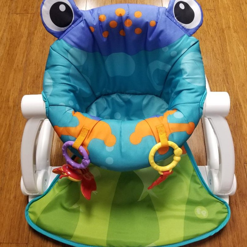Fisher Price Sit Me Up Floor Seat - Frog<br /> Has 2 removable hang-on toys<br /> Fabric machine washable<br /> In excellent condition.<br /> Retail $40 & up<br /> * STORE PICKUP ONLY, NO SHIPPING.<br /> ** WE OFFER FULL CURBSIDE SERVICE.