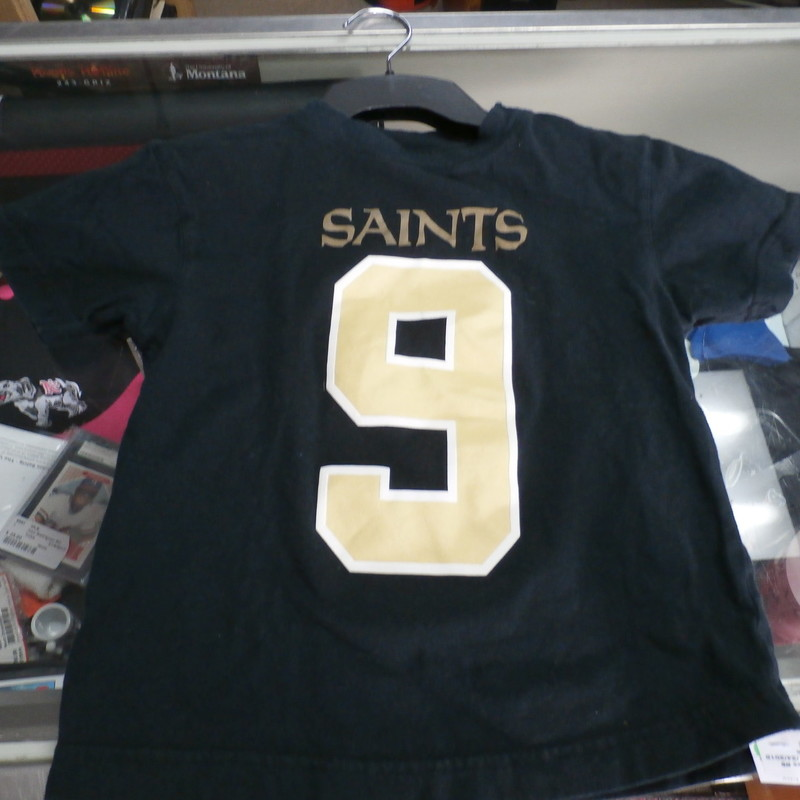 "New Orleans Saints #9 Drew Brees YOUTH shirt size Medium 5/6 black cotton #19212<br /> Rating:   (see below) 3- Good Condition<br /> Team: New Orleans Saints<br /> Player: Drew Brees #9<br /> Brand: NFL<br /> Size :  Medium 5/6 - YOUTH ( Chest: 13"" x Length: 17"" ) measured armpit to armpit and shoulder to hem<br /> Color: Black<br /> Style: Crew neck shirt; short sleeve; screen pressed<br /> Material :  100% Cotton;<br /> Condition: 3 -Good Condition -  noticeable pilling and fuzz; wrinkled; fabric is slightly faded and discolored from washing and use;<br /> Item #: 19212<br /> Shipping: FREE"