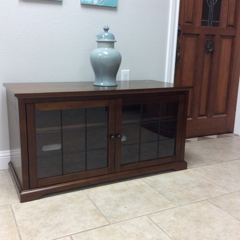 BARGAIN ALERT!! This entertainment cabinet is from the Pamari Collection. Although it is small it is big in personality. It features a dark wood finish, adjustable shelving and attractive glass-paned cabinet doors. All for $195.00!
