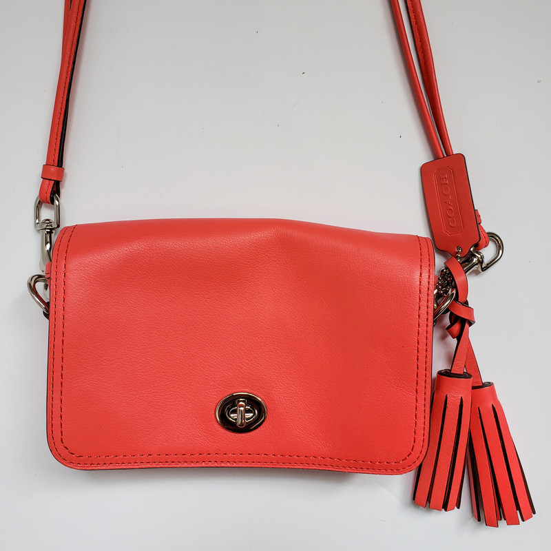 Coach<br /> Leather crossbody in Coral<br /> Double strap with tassels