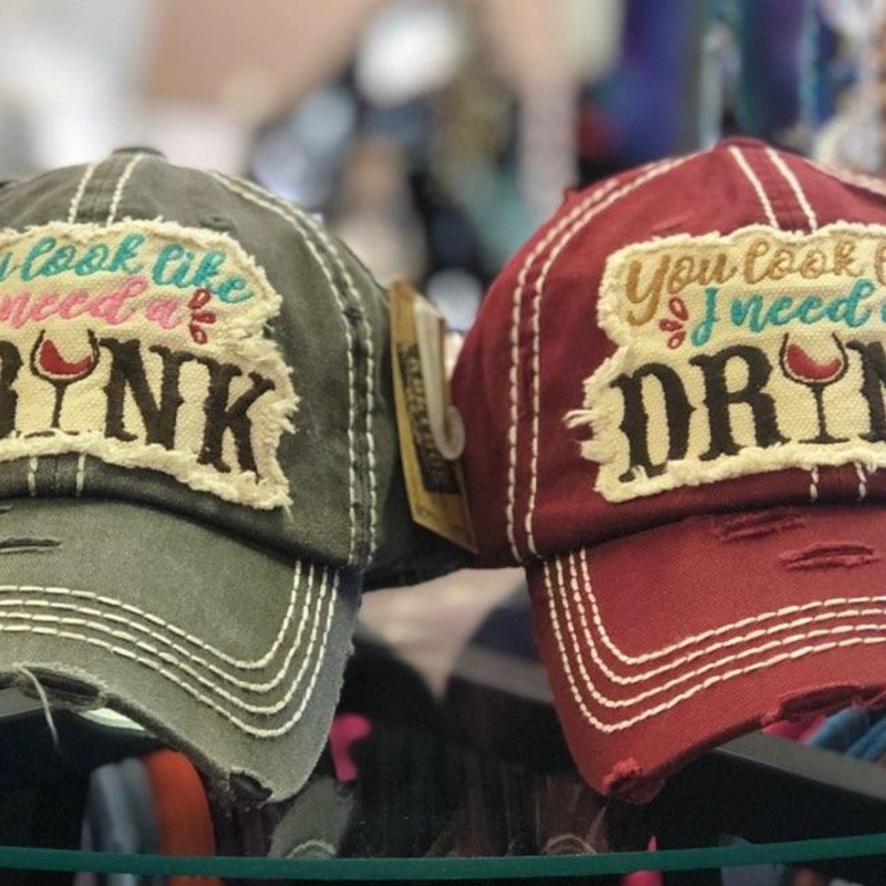 "U Look Like Need DRINK, 2 Colors, Size: Adjusts<br /> These Hats are Brand New from the Tara Bella Boutique!<br /> You Have a choice of colors, Burgundy or grey<br /> The Quote is: ""You Look Like I Need A Drink""<br /> Adjustable<br /> $16.00 each<br /> Makes A WONDERFUL GIFT!"