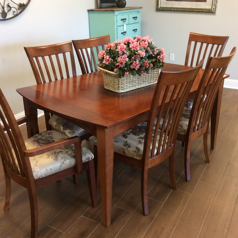 "This mid-century modern dining set is in fabulous condition! It features solid wood construction and has a cherry finish. When the 12"" leaf is inserted, the table measures a full 78"" long. 2 of the 6 chairs have arms, and the neutral upholstery is in excellent condition."