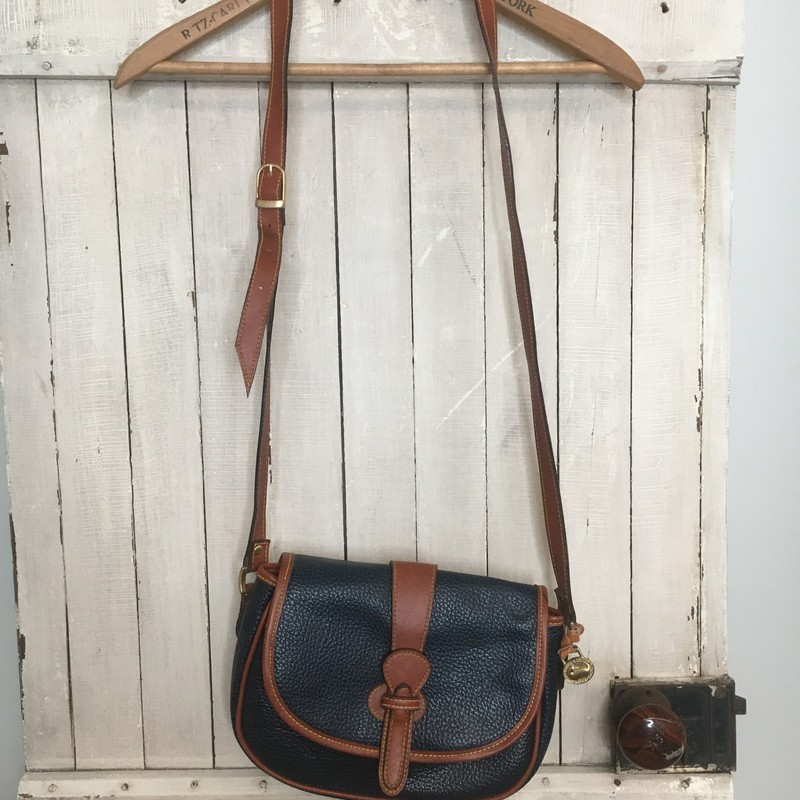 1990's Equestrian Saddlebag Crossbody, Dooney & Bourke, Navy.  Near perfect exterior.  Very slight fading of interior leather.<br /> 10 x 8 x 3
