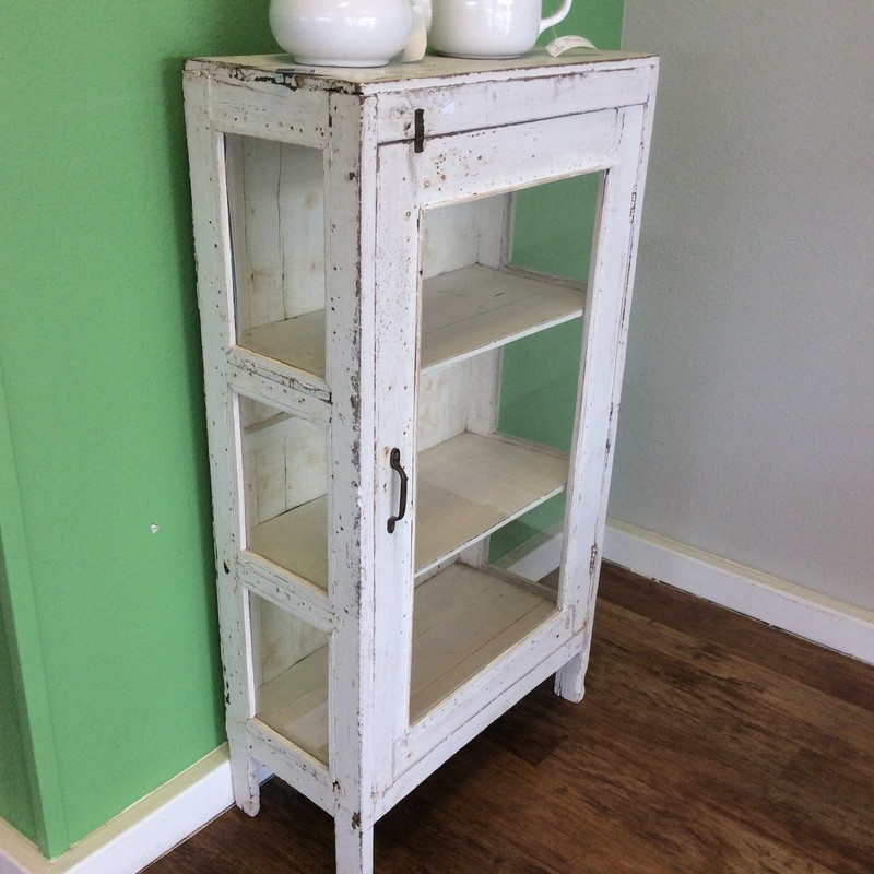 I'm not sure why it's called a chippy chest, but this little vintage piece is very farm-housy looking. The door on the front, as well as both sides, features glass panes. There are 2 sturdy shelves inside, and it has the original hardware. Stop by and check it out!