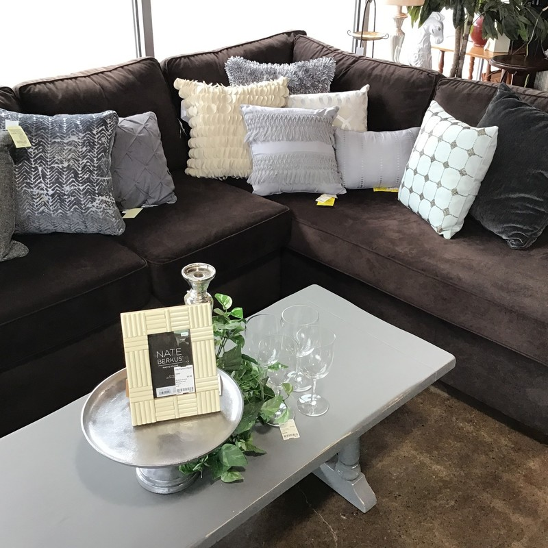 "This super comfy sectional is perfect for the family that hosts movie nights! It is upholstered in a dark brown fabric (and bonus - there are 2 extra covers for the chaises!!) and the seat cushions are all flippable. The back cushions are stationary, but have zippers on the bottom so you can ""fluff"" them! This piece is very large, but would be great in that big family room, basement or gameroom!<br /> Dimensions are 13' across, 7' deep and 36"" high"
