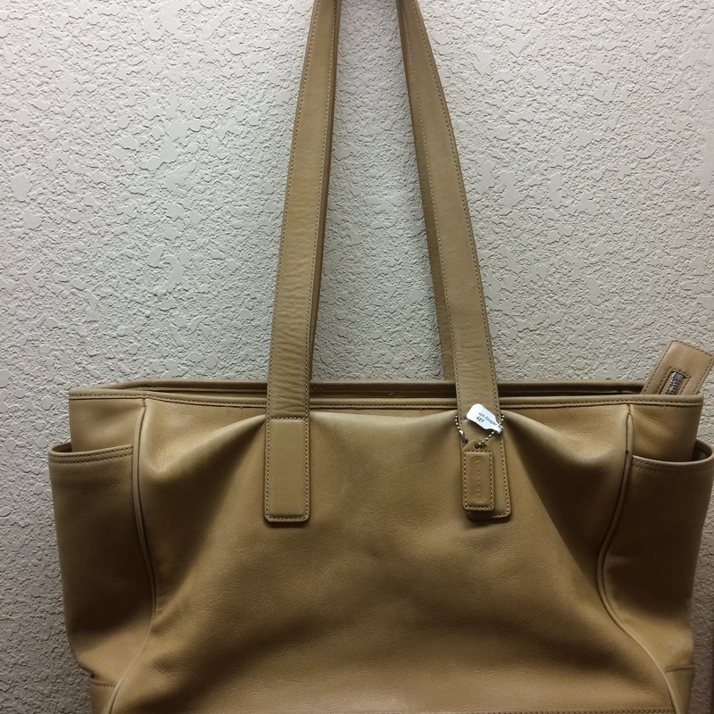 Coach Tote. Extra large buttery leather bag. You can fit a lap top or it would make a grest diaper bag! Measures 12 in x 16 in. Some wear on the bottom but overall good condition.