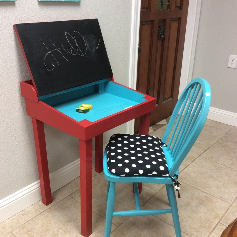 Hey, they're at home anyway, right?? This would be the perfect little ensemble for online learning! The desk has been painted a vibrant red and blue and the inside of the desktop is a blackboard. How cool is that? The chair, also  brilliant blue, includes a black & white polka dot cushion. It's just adorable...