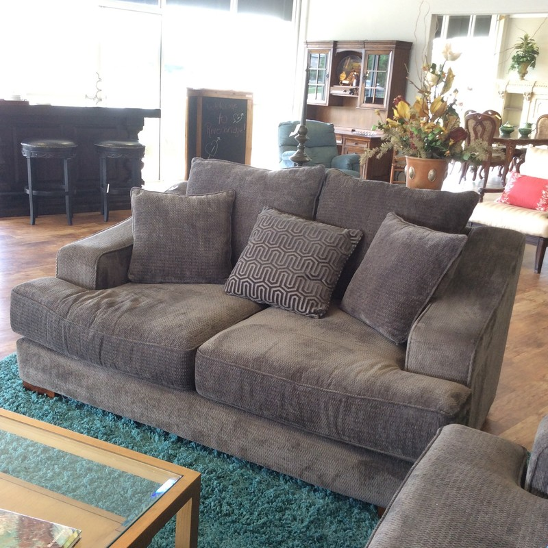Love your lounge! Kick back, relax and social distance in casual comfort with this beauty. This loveseat features supersoft chenille  for a contemporary feel with a touch of glam. T-style cushions  and sloped track arms provide a sophisticated transitional look.  All in a soothing pewter.  Come by soon and try it out!