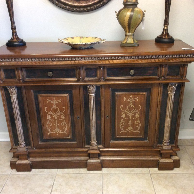 This is a stunning piece! It was made in Italy by TURAZZA, in a joint venture with HEKMAN. It features solid wood construction and has a cherry finish. There is an abundance of exquisite carved details, that truly set this apart from similar pieces. There is also a painted motif on the fron of the cabinet doors.