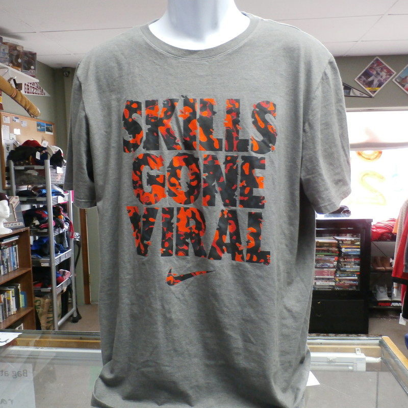 "Nike Men's Athletic Cut ""Skills Gone Viral"" Short Sleeve Shirt Gray Size XL #19917<br /> Rating:   (see below)2- Great Condition<br /> Team: n/a<br /> Player: n/a<br /> Brand: Nike<br /> Size: XL - Men's  (Measured: 21"" Wide, length 30"")<br /> Measured: Armpit to armpit; shoulder to hem<br /> Color: Gray<br /> Style: short sleeve; screen pressed; athletic cut; ""Skills Gone Viral""<br /> Material: 50 Cotton 50 Polyester<br /> Condition: 2- Great Condition - fabric is crisp; screen press has not cracks or peeling; no rips, tears, or stains, slightly stretched fro use and wash; (see photos)<br /> Item #: 19917<br /> Shipping: FREE"