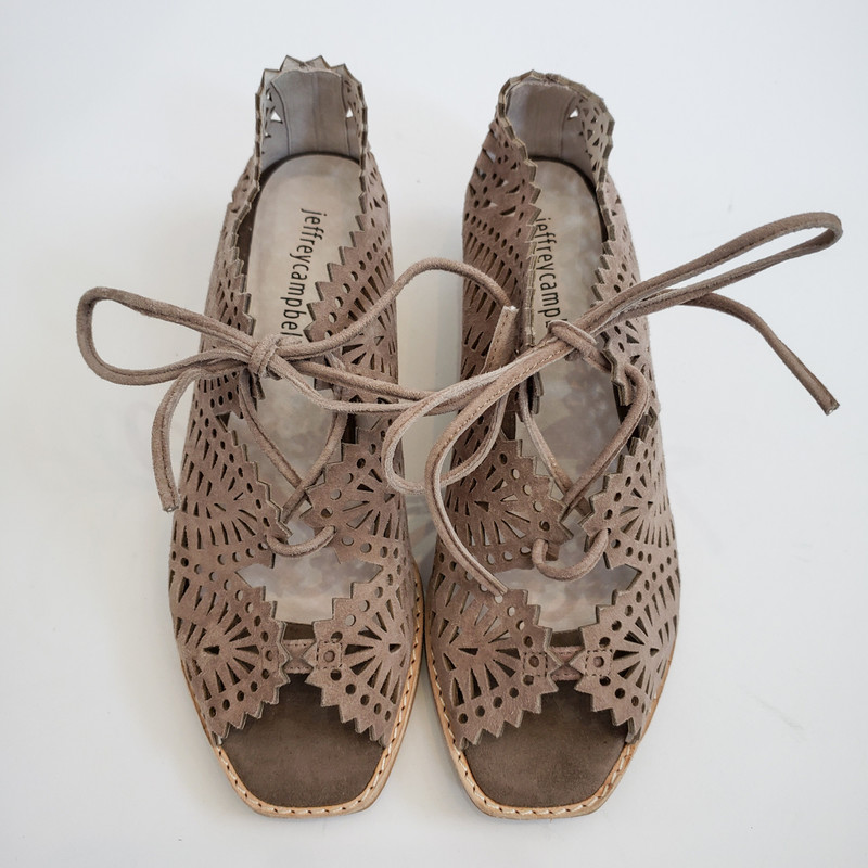 Jeffrey Campbell<br /> Mini wedge cut out sandals<br /> Original Retail $150<br /> Taupe<br /> Size: 7<br /> Comes with BOX