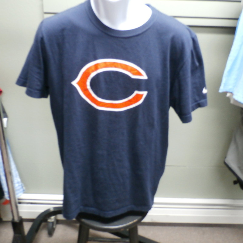 Chicago Bears Men&#039;s t shirt blue size Large Regular Fit Nike 100% Cotton #19077<br /> Rating:   (see below) 4- Fair Condition<br /> Team: Chicago Bears<br /> Player: Team<br /> Brand: Nike<br /> Size : Large - Men&#039;s ( Chest: 21&quot; x Length: 25&quot; ) measured armpit to armpit and shoulder to hem<br /> Color: Blue<br /> Style: t shirt; screen pressed<br /> Material :  100% Cotton<br /> Condition: 4 -Fair Condition -  light pilling and fuzz; wrinkled; fabric is slightly faded and discolored from washing and use; this is a nice clean shirt with a small hole on the lower front; Bear Down Chicago Bears - Great shirt for wearing around the house or working in the backyard;<br /> Item #: 19077<br /> Shipping: FREE