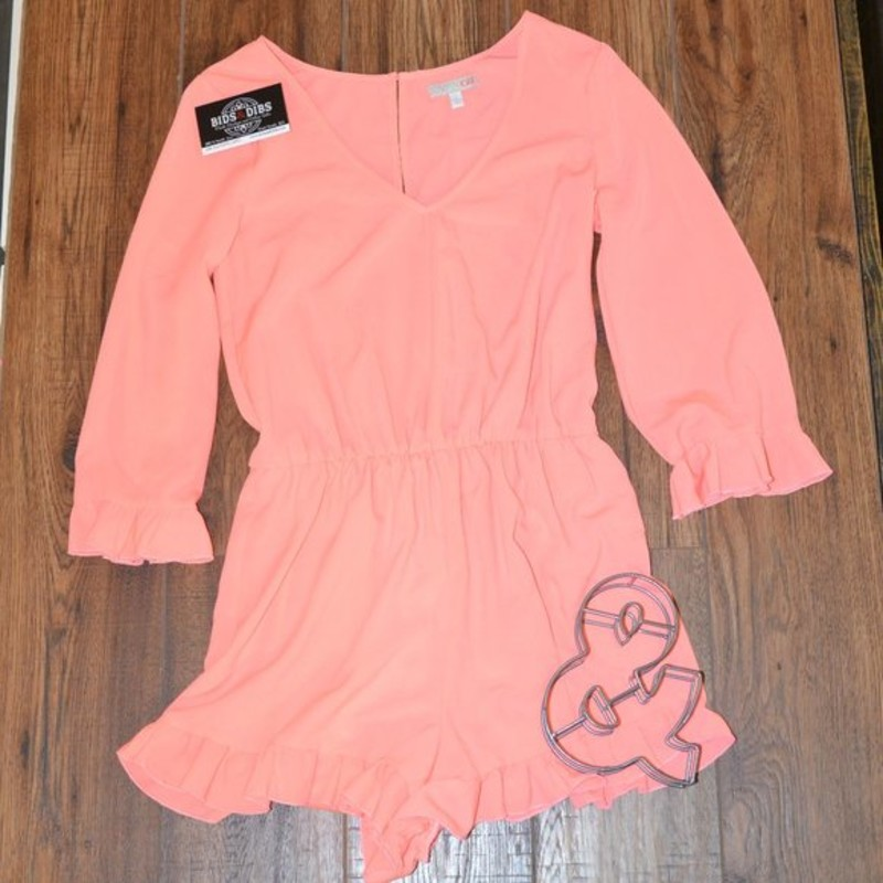 -GB Brand<br /> -Coral colored<br /> -Elastic waist<br /> -Ruffle son the sleeves and shorts<br /> -Button in the back<br /> -No snags or tears<br /> -Excellent condition<br /> -Size small