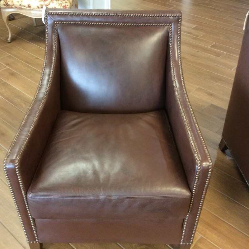 Believe it or not, the original price for this chair was $3000, from the Design Center in Houston. Considering that, $595 seems like a steal, doesn't it? It has a solid wood frame and is upholstered entirely in chocolate coloed leather. It has hundreds of pewter nailhead accents, too. There are actually 4 of these, each priced seperately.