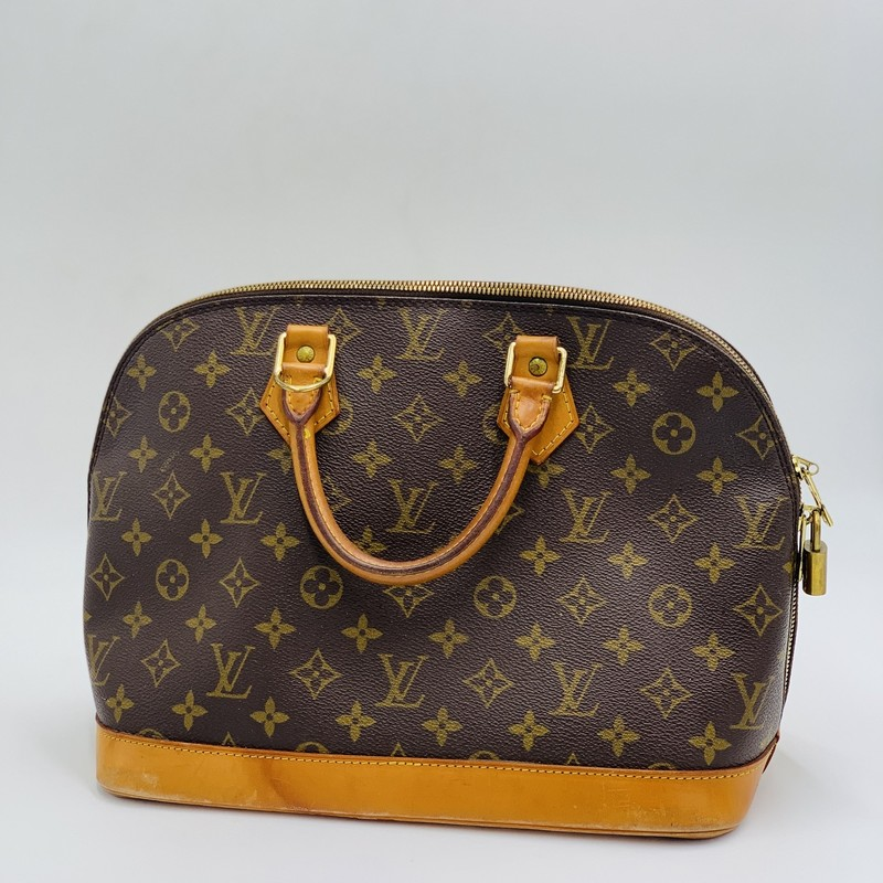 "Louis Vuitton Alma PM, Monogram, Size: OS<br /> <br /> condition: FAIR. Heavy staining to bottom. Moderate wear/patina of handles. Interior is clean.<br /> <br /> estimated retail: $1580<br /> <br /> 12""W x 9.5""H x 6.5""D<br /> 3"" handle drop<br /> <br /> We guarantee the authenticity of every bag on our site. Each bag comes with either an original sales receipt, original tags, receipt from a trusted reseller, or a Certificate of Authenticity from AuthenticateFirst.com. Established in 2013, AuthenticateFirst.com (http://authenticatefirst.com) is one of the premier authentication services in the US, providing authentications of designer handbags, wallets, small leather goods, footwear, jewelry, and accessories. They employ in-house experts who have decades of experience working with hundreds of luxury brands."
