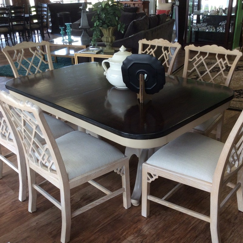 This is a lovely set! The consignor did a fabulous job painting the table, and it's vintage style still shines through. The table is solid oak and has a double pedestal base. The 6 THEO ALEXANDER chairs were purchased at Donna's 2 years ago, and are in excellent condition.