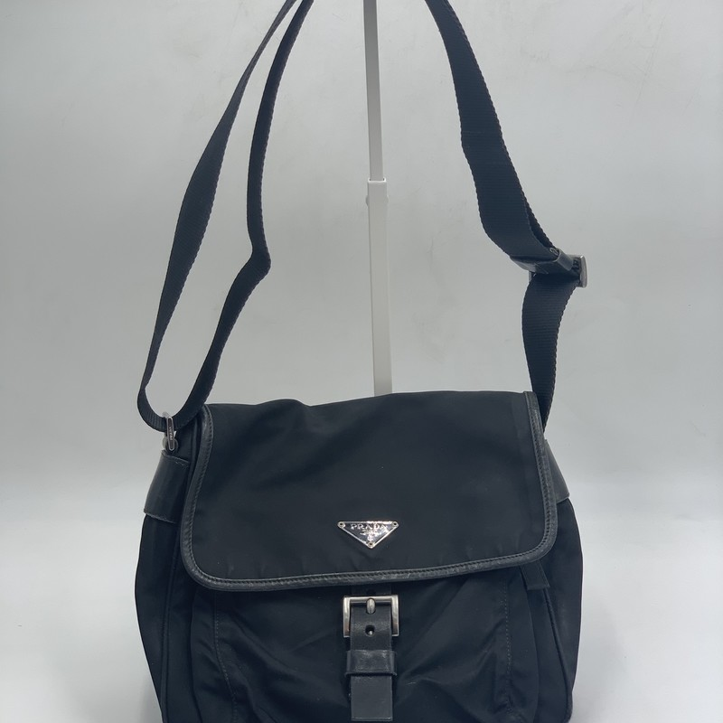 "Prada Tessuto Messenger, Black, Size: OS<br /> <br /> condition: FAIR. mild staining, considerable wear to leather trim<br /> <br /> 9.5""H x 9.5""W x 4""D<br /> 18"" strap drop<br /> <br /> We guarantee the authenticity of every bag on our site. Each bag comes with either an original sales receipt, original tags, receipt from a trusted reseller, or a Certificate of Authenticity from AuthenticateFirst.com. Established in 2013, AuthenticateFirst.com (http://authenticatefirst.com) is one of the premier authentication services in the US, providing authentications of designer handbags, wallets, small leather goods, footwear, jewelry, and accessories. They employ in-house experts who have decades of experience working with hundreds of luxury brands."