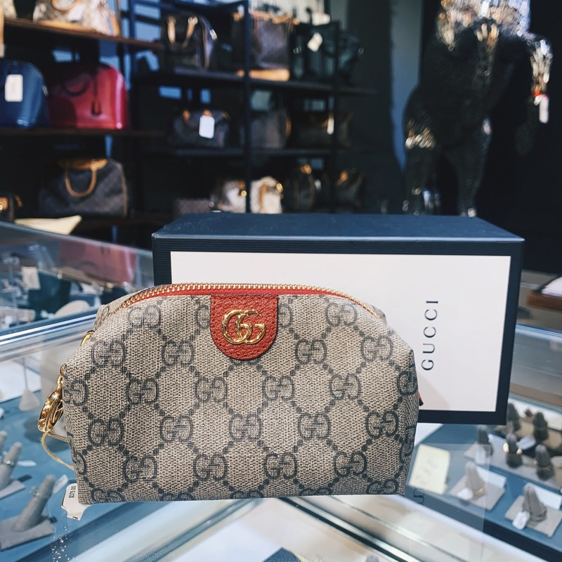 Gucci Cosmetic Bag with gold hardwear<br /> <br /> Like new condition, comes with boxes and receipts