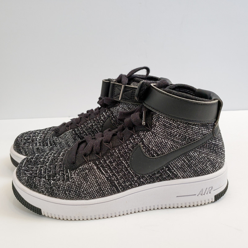 Nike<br /> Ultra Flyknit High Top<br /> Black and white<br /> Size: 7