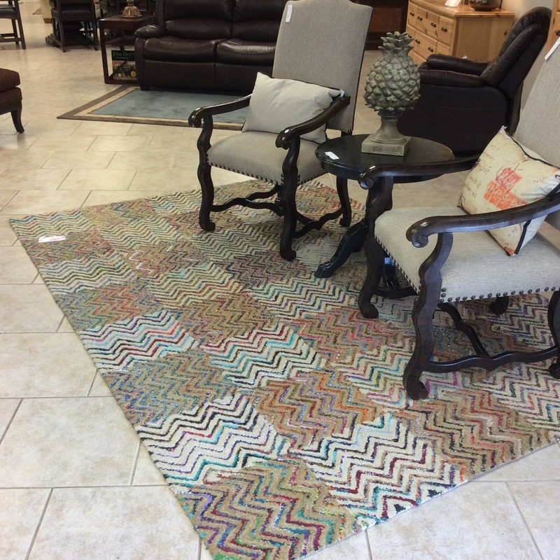 This is a very cool and fun rug! It features a bric - a -  brac, zig zag  pattern with every color under the sun imaginable! Good condition.