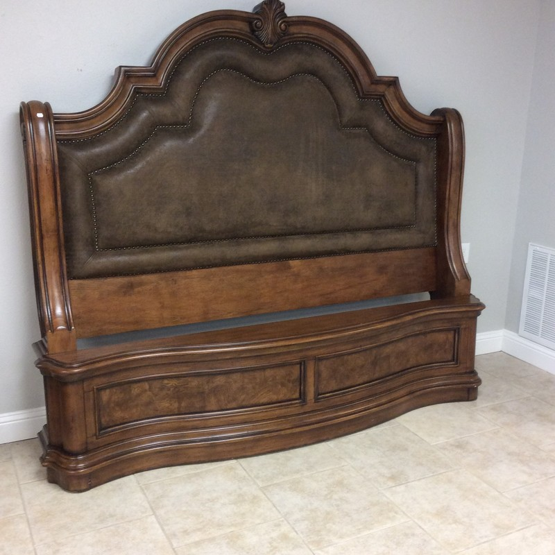This PULASKI bed is not for the Faint-of-Heart! Large and dramatic - it's The San Mateo Sleigh Bed. King-sized, It features a dark wood finish that's been distressed giving it that popular weathered, aged look. The headboard has a leather tufted back with a double nailhead trim. Beautifully carved woodwork throughout.