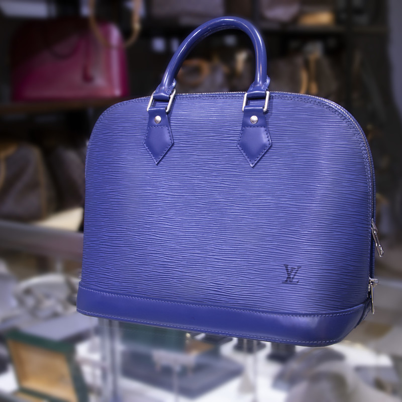 Louis Vuitton Alma PM EPI, Blue, Size: BAHH<br /> <br /> Blue 100% leather Louis Vuitton Alma Myrtilles Epi from Louis Vuitton Pre-Owned featuring top handles, a two way zip fastening, a front embossed logo stamp and an internal slip pocket.<br /> <br /> Made in France<br /> <br /> Width	12 in<br /> Height	9.4 in<br /> Handle	3.5 in<br /> Depth	6.5 in
