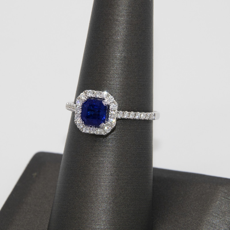 18K White Gold .96 Carat Sapphire surrounded by 0.26 carat Diamonds in halo setting with pave band<br /> <br /> #sapphire #ring #wedding #anniversary #engagement #diamond #new