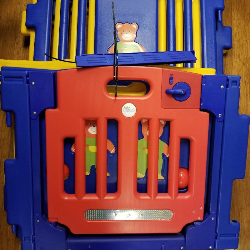 Baby Diego Cub Zone Playpen & Activity Center Yellow, Blue & Red<br /> Strong panels, hinged door with safety lock<br /> Interactive activities, educational fun & development<br /> Recommended ages 6-24mo.<br /> 8 individual panels 31 x 23.5 inches<br /> Retail price $140.00 & up<br /> More info found online<br /> NO SHIPPING, STORE PICKUP ONLY