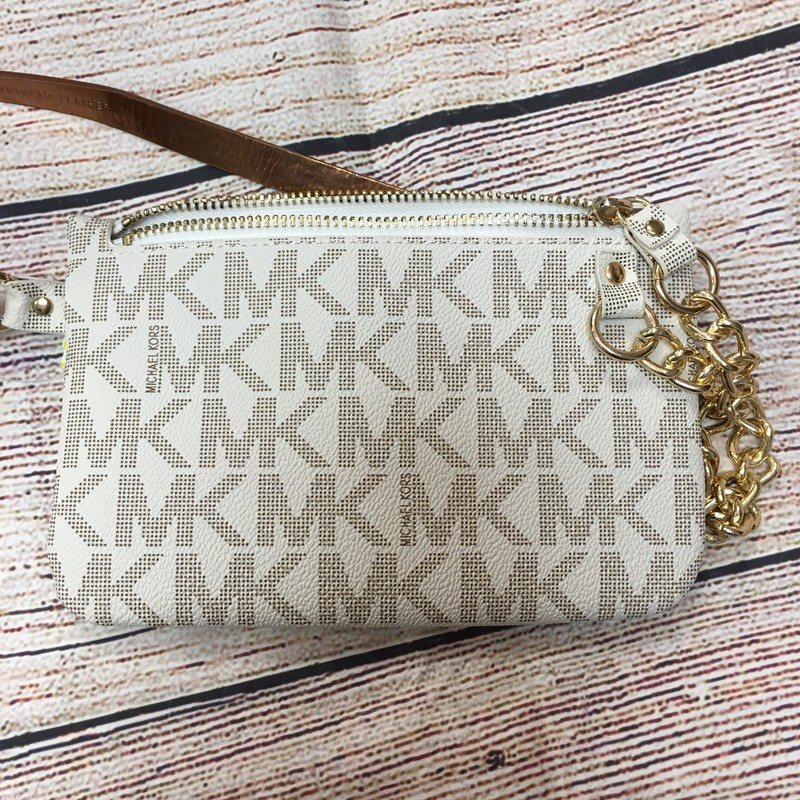 MK cream and tan adjustable belt bag.  Zipper closure and chain detail wtih bronze interior.  Size small with three adjustable gold buttons.