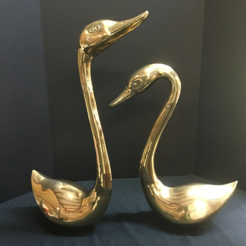 Mid Century Brass Swan pair. Taller swan is 26 inches high. Beautiful condition!