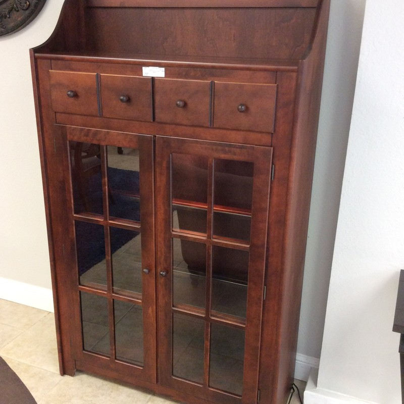 This is just as sweet as can be! It is made by CANADEL, out of Cananda and is constructed entirely of maple. The 2 drawers are dovetailed and the cabinet has 2 wood and glass shelves. It has a gorgeous dark cherry stained finish. Only $395!!