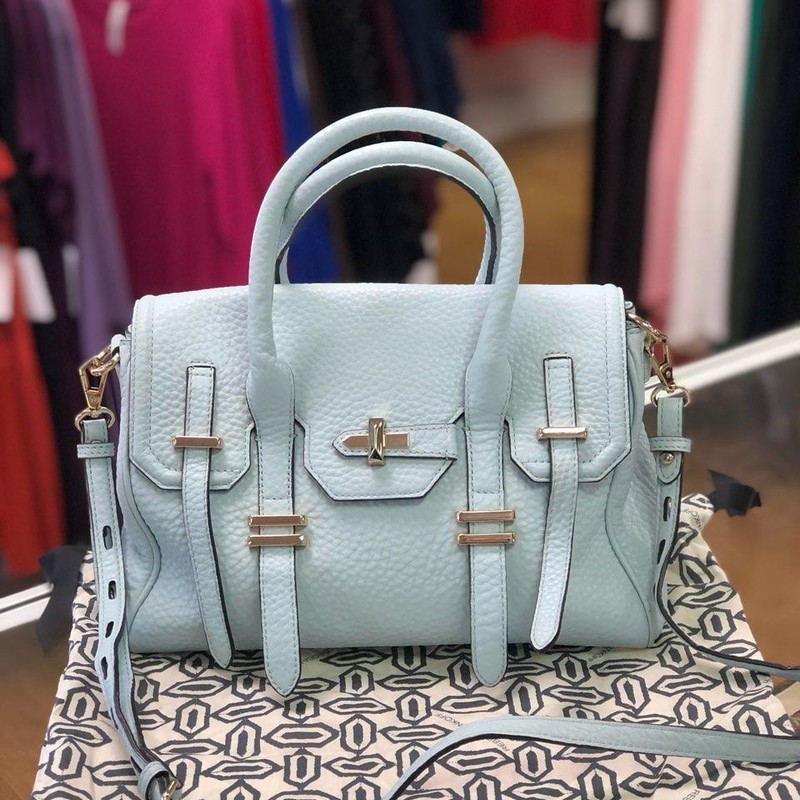"Rebecca Minkoff, SkyBlue, Size: Authentic<br /> SIZE INFO:<br /> 15 ¼""W x 10 ½""H x 5 ¾""D. (Interior capacity: large.)<br /> 3 ½"" strap drop; 9 ¼"" - 14 ½"" shoulder strap drop.<br /> DETAILS & CARE:<br /> A prim, lightly structured silhouette with vintage DNA gets a gorgeous update in grainy leather with sleek, modern hardware. Rolled handles and an optional, adjustable shoulder strap provide convenient carrying options.<br /> Magnetic snap-flap closure.<br /> Interior zip, wall, card and cell-phone pockets.<br /> Protective metal feet.<br /> Signature print lining.<br /> Leather.<br /> By Rebecca Minkoff; imported.<br /> Retails for $295.00<br /> This handbag is preowned, in like new condition.  No marks, stains or flaws."