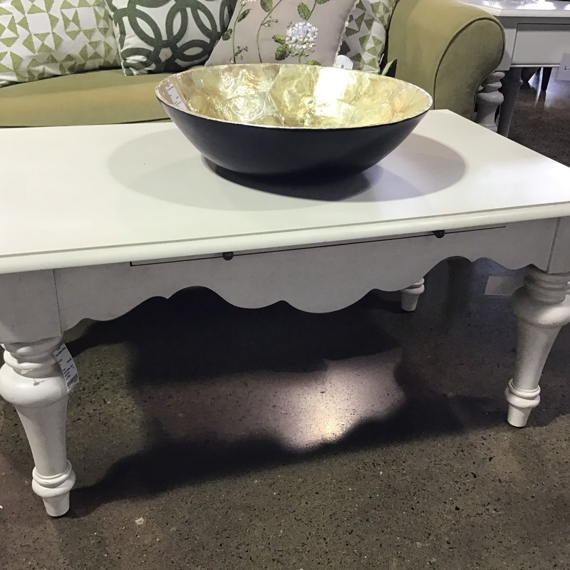 "Are you looking to update your family room with farm-style tables? Check out this pretty white coffee table with turned legs! It even has a pull-out shelf for eating or serving! Not a huge table and would be great with any color sofa!<br /> Dimensions are 40"" x 24"" x 19"""