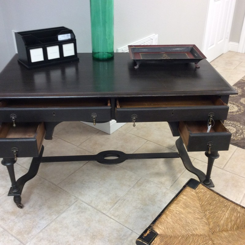 This sweet little ANTIQUE desk has been purchased and sold here a few times already. It is on the smaller side, measuring a bit over 4 ft. wide by a bit over 2 ft. deep, and would be perfect for a lady. It is solid wood, there are 4 small drawers and it rolls on 4 itty bitty casters.