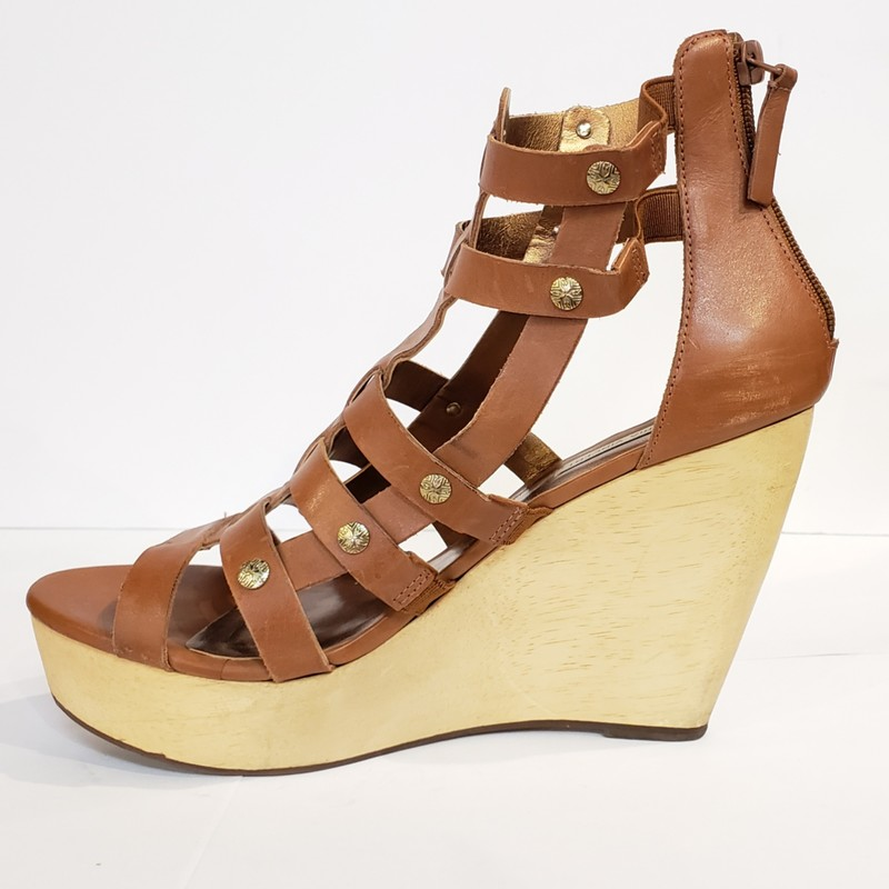 Cynthia Vincent Tall Wedge<br /> Brown Leather Upper<br /> Wood Lower<br /> Size: 9<br /> Made in Brazil<br /> <br /> 4.5 inch Heel<br /> 1.5 inch platform