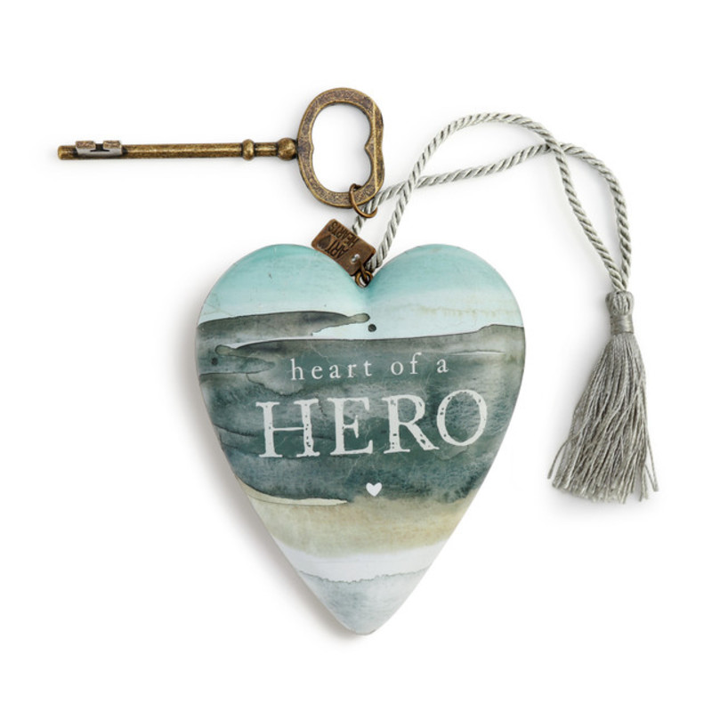 "Size: 3.5""w x 3.5""h<br /> Materials: resin, paper, nylon, metal, iron<br /> Sentiment: Heart of a hero"