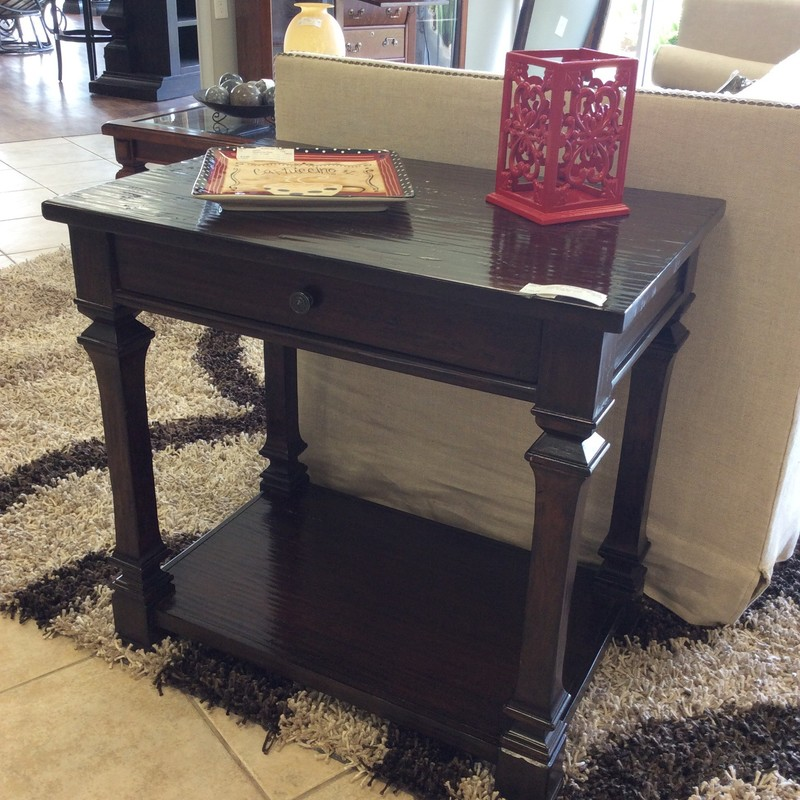 This end table by Bernhardt is gorgeous! Rough-hewn, hand-scraped in a rich espresso that is just slightly rustic in style but versatile. This piece could be used with just about any decor, it has classic lines and it's beauty is in it's simplicity. It features a single but roomy drawer. Best of all, it has a matching accent table priced separately.