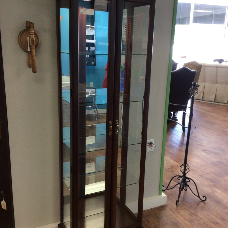 BARGAIN ALERT!!! This curio cabinet is a great size. It's 6 feet tall, but less than 2 feet wide and only 1 foot deep. It is lighted inside, has 4 adjustable glass shelves and is mirrored on the back. It is solid wood and glass, and has a walnut finish. ONLY $225!