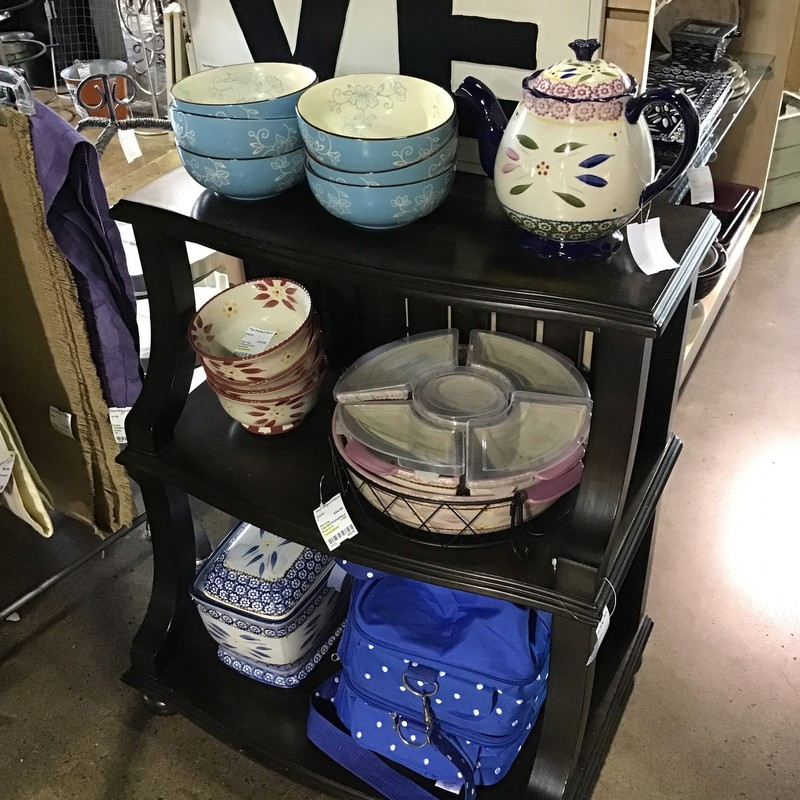 "An unusual accent table featuring three shelves for displaying you decor.  Could also make a cute bookshelf or cookbook holder.<br /> <br /> Dimensions:  26""W x 17""D x 29.5""H"